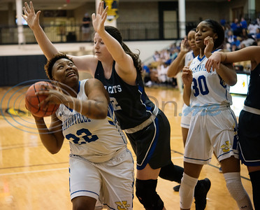 Jacksonville's Tyshera Gipson (22) is fouled by Sulphur Springs' Hannah Cordell (32) during the first half of their bi-district playoff basketball held at Wagstaff Gymnasium in Tyler on Monday, Feb. 17, 2020.  (Sarah A. Miller/Tyler Morning Telegraph)