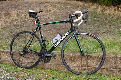"Cervelo R5 (Production version R5). 2011 Campy 11. Rotor ""Sastre"" rings - special elliptical set where the inner ring has the exact same elliptical shape as the outer ring (this is not standard).   Rear hub is PowerTap.   Has winter stuff on it (top tube is wrapped up front where I set the battery for the night light)."