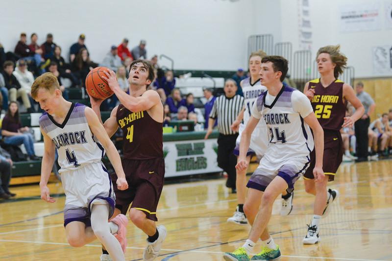 Joel Moline | The Sheridan Press<br /> Big Horn High School's Carson Bates (4) scores a layup against Glenrock High School Saturday,  Jan. 11, 2019.