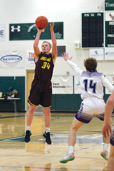 Joel Moline | The Sheridan Press<br /> Big Horn High School's Quinn McCafferty (34) drains a 3-pointer against Glenrock High School Saturday,  Jan. 11, 2019.