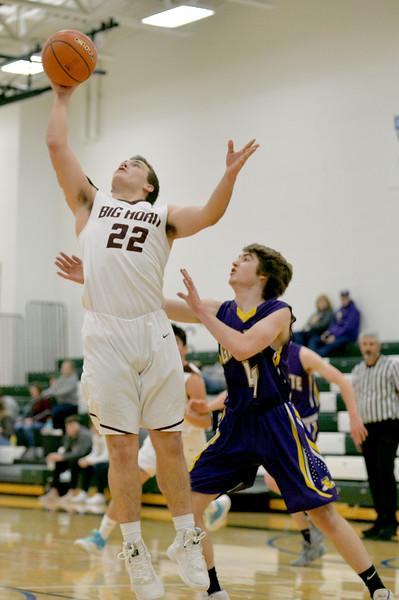 Joel Moline | The Sheridan Press<br /> Big Horn's Cutler Bradshaw (22) scores a layup against Campbell County High School JV Friday, Jan. 10, 2019.