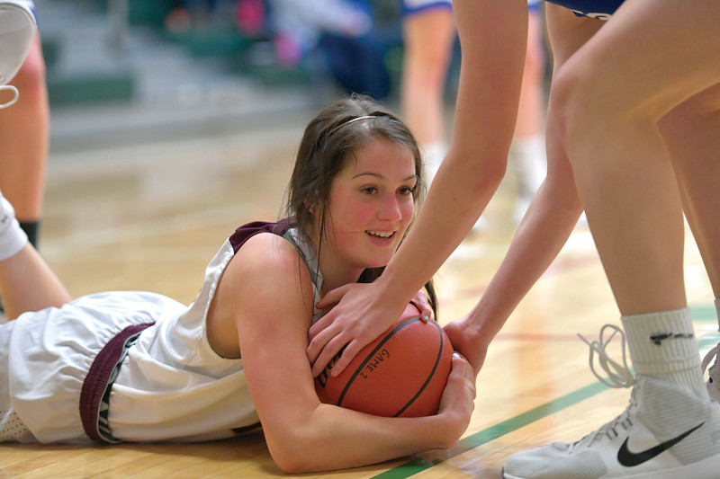 Matthew Gaston | The Sheridan Press<br>Big Horn's Madison Butler (13) wraps up a loose ball during play against Thunder Basin Friday, Jan. 10, 2020.