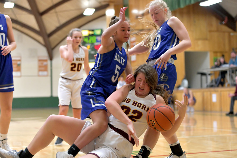 Matthew Gaston | The Sheridan Press<br>Big Horn's Amelia Gee (22) is blatantly fouled by Thunder Basin's Jayden Friedly (5) Friday, Jan. 10, 2020.