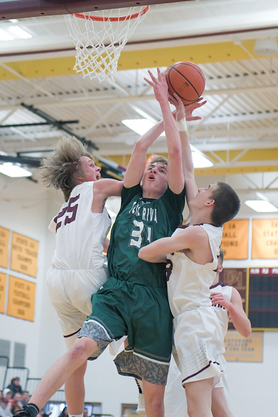 Ashleigh Snoozy | The Sheridan Press<br>Tongue River's Sam Patterson is fouled by Big Horn's Ayden Phillips at Big Horn High School Saturday, Jan. 18, 2020.