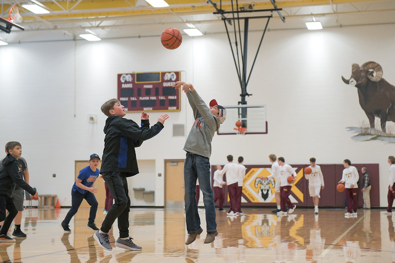 Ashleigh Snoozy | The Sheridan Press<br>Boys play a pick-up basketball game during halftime of the high school basketball game at Big Horn High School Saturday, Jan. 18, 2020.