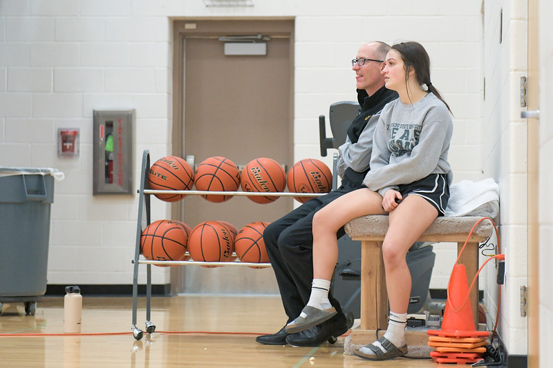 Ashleigh Snoozy | The Sheridan Press<br>Big Horn High School girls basketball head coach Kip Butler, left, chats with Madison Butler (13) Saturday, Jan. 18, 2020.