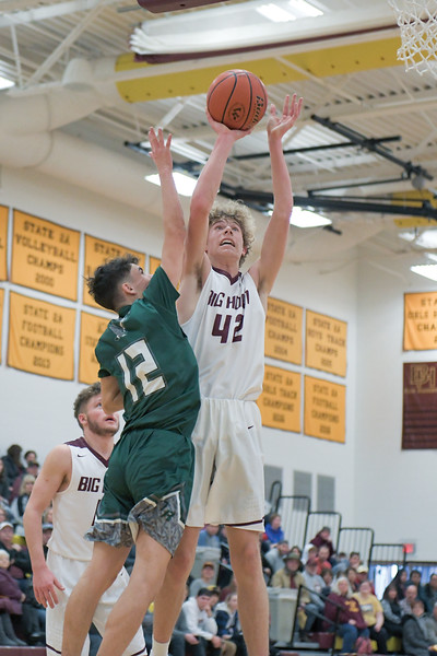 Ashleigh Snoozy | The Sheridan Press<br>Big Horn's Tobias Schons goes up for a shot against Tongue River's Braden McCafferty during action Saturday, Jan. 18, 2020. The Rams beat the Eagles, 51-39.