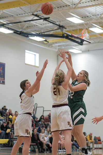 Ashleigh Snoozy | The Sheridan Press<br>Tongue River's Sadie Koltiska (42) goes up for a shot against the Big Horn High School defense Saturday, Jan. 18, 2020.