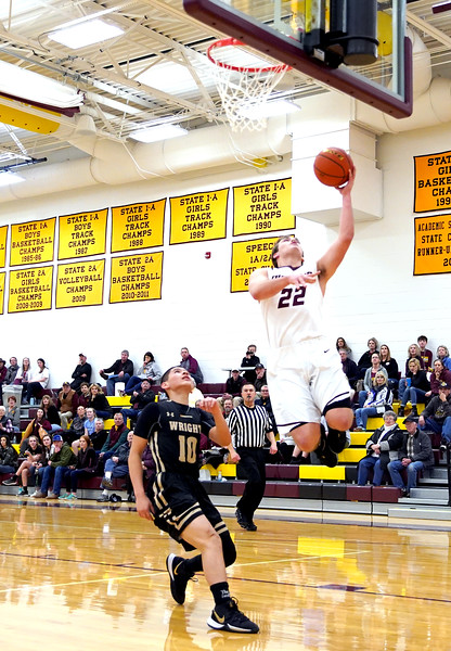 Matthew Gaston | The Sheridan Press<br>Big Horn's Cutler Bradshaw (22) gets some air to score two against Wright Friday, Jan. 31, 2020.