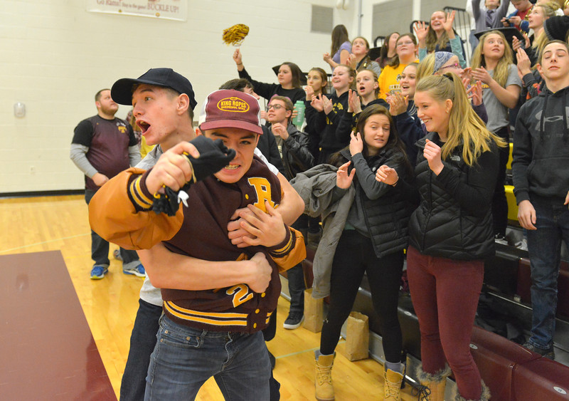 Justin Sheely   The Sheridan Press<br /> <br /> Big Horn students Roman Ziniga, right, catches a free T-shirt as Liam Greenelsh celebrates at Big Horn High School Friday, Feb. 9, 2018.