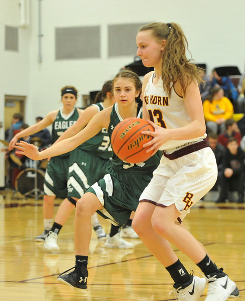 Justin Sheely   The Sheridan Press<br /> <br /> Tongue River's Holly Hutchinson, left, guards Sydney Schmidt at Big Horn High School Friday, Feb. 9, 2018. Big Horn Lady Rams won 47-28.