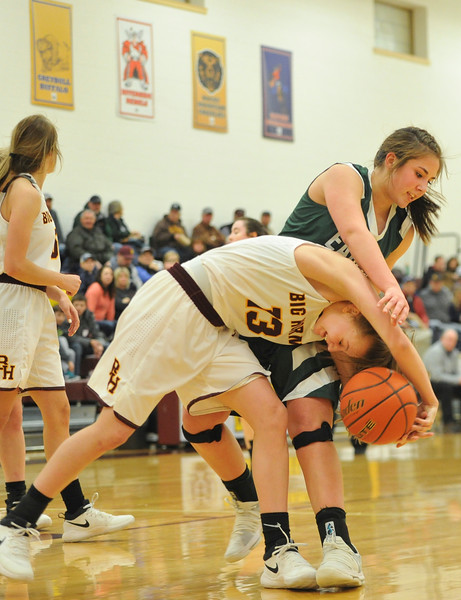 Justin Sheely   The Sheridan Press<br /> <br /> Tongue River's Zaveah Kobza, right, tires to strip the ball from Big Horn's Sydney Schmidt at Big Horn High School Friday, Feb. 9, 2018. Big Horn Lady Rams won 47-28.