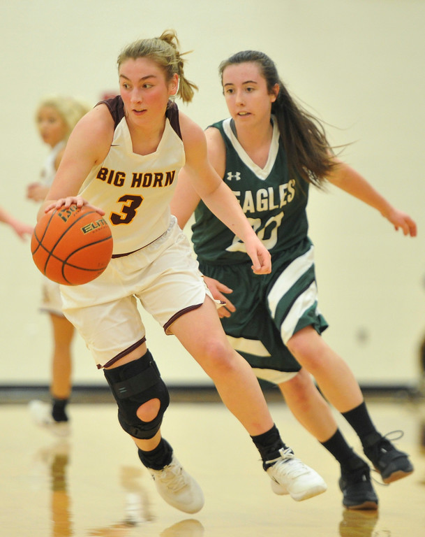 Justin Sheely | The Sheridan Press<br /> <br /> Big Horn's Jill Mayer, left, moves the ball up court against Tongue River's Jenna Keller at Big Horn High School Friday, Feb. 9, 2018. Big Horn Lady Rams won 47-28.