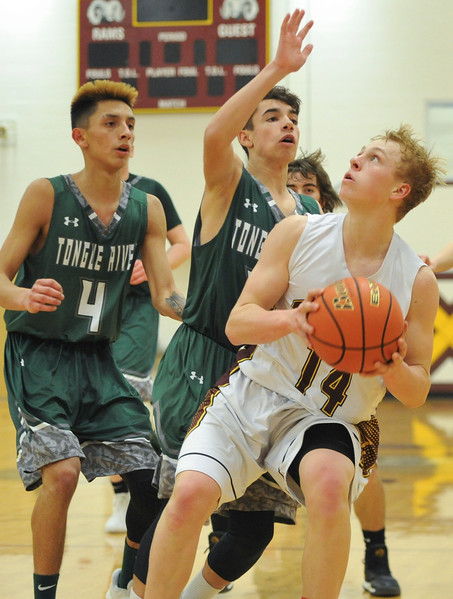 Justin Sheely   The Sheridan Press<br /> <br /> Big Horn's Quinn McCaffery, right, looks for a shot against Tongue River's Jay Keo (4) and Braden McCafferty at Big Horn High School Friday, Feb. 9, 2018. The Rams won 72-55.