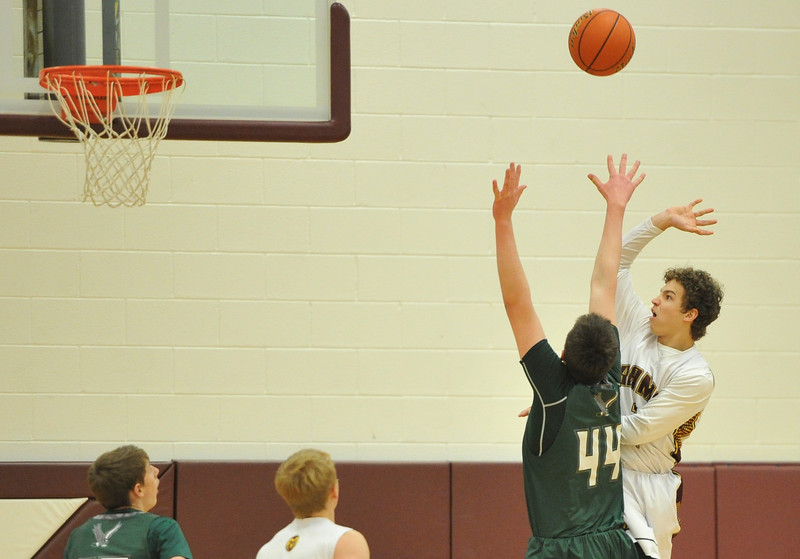 Justin Sheely   The Sheridan Press<br /> <br /> Big Horn's Kade Eisele, right, shoots for two over Tongue River's Hugh Patterson at Big Horn High School Friday, Feb. 9, 2018.