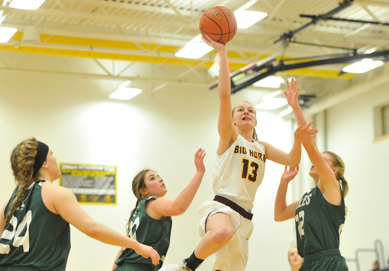 Justin Sheely   The Sheridan Press<br /> <br /> Big Horn's Sydney Schmidt (13) shoots against Tongue River's Zaveah Kobza, left, and Kalie Bocek, right, at Big Horn High School Friday, Feb. 9, 2018. Big Horn Lady Rams won 47-28.