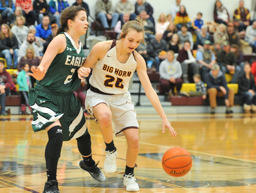 Justin Sheely | The Sheridan Press<br /> <br /> Big Horn's Courtney Wallach, right, drives against Tongue River's Nikki Perfetti at Big Horn High School Friday, Feb. 9, 2018. Big Horn Lady Rams won 47-28.