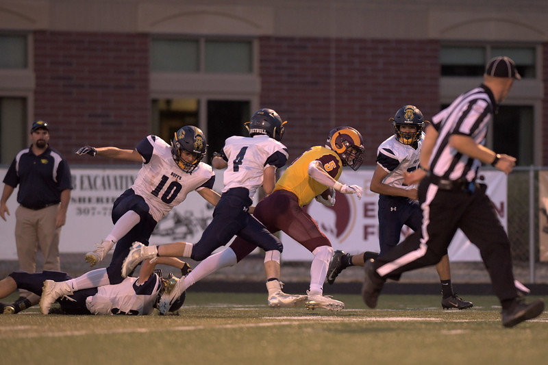 Matthew Gaston | The Sheridan Press<br>Big Horn's Will Pelissier (5) bullies his way through Greybull's defense before being brought down at the three yard line Friday, Sept. 13, 2019.