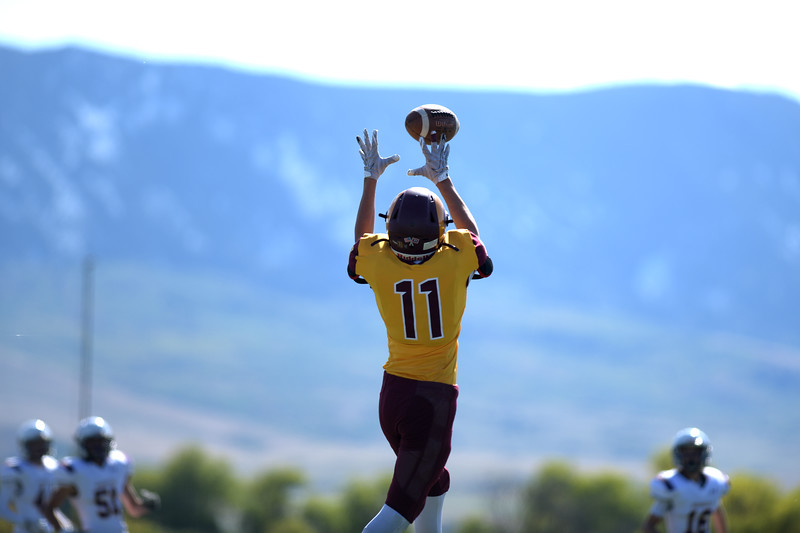 Matthew Gaston | The Sheridan Press<br>Big Horn's Jame Richards (11) catches some air in an attempt to make the reception during play against Pine Bluffs Friday, Oct. 4, 2019. The Rams won 52-2
