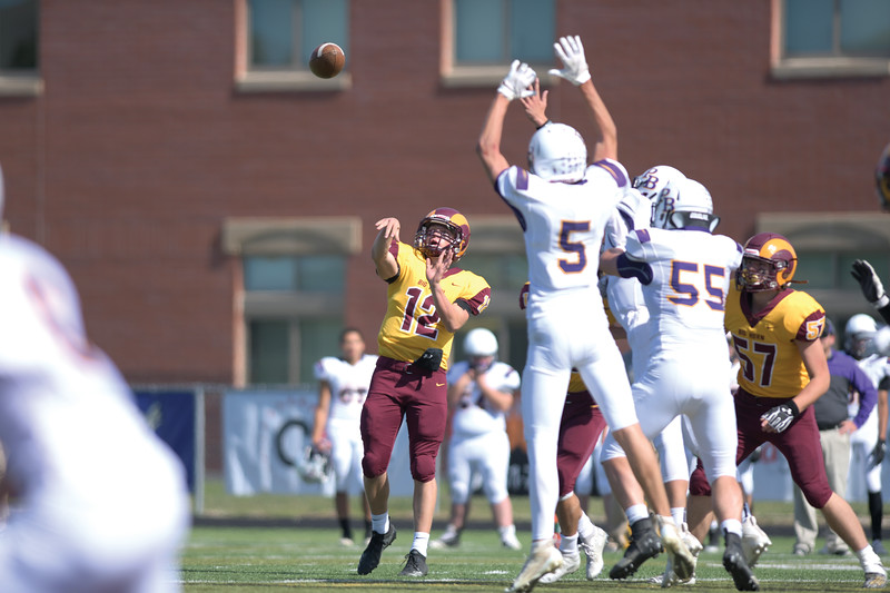 Matthew Gaston | The Sheridan Press<br>Big Horn's Quinn McCafferty (12) lauches a pass to Luke Mullinax resulting in touchdown against Pine Bluffs Friday, Oct. 4, 2019.