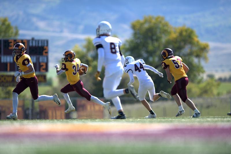Matthew Gaston | The Sheridan Press<br>Big Horn's Will Pelissier (5) clears a path through the Pine Bluffs defense for Kyler Ostler (34) Friday, Oct. 4, 2019. The Rams won 52-2