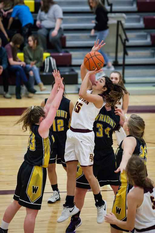 Tibby McDowell | The Sheridan Press<br /> <br /> Jenny Trabert puts up two against Wright at Big Horn High School Friday Jan. 26, 2018.