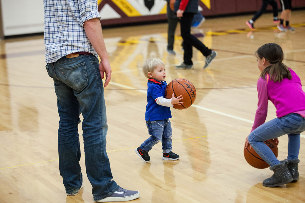 Tibby McDowell | The Sheridan Press<br /> <br /> Dash Distler, center, plays basketball during half-time of the boys basketball game with his dad Donnie Distler, right, and Hayden Rosselott at Big Horn High School Friday Jan. 26, 2018.