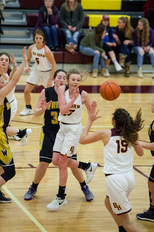 Tibby McDowell | The Sheridan Press<br /> <br /> Jordan Frank, left, passes the ball to Jenny Trabert against Wright at Big Horn High School Friday Jan. 26, 2018.