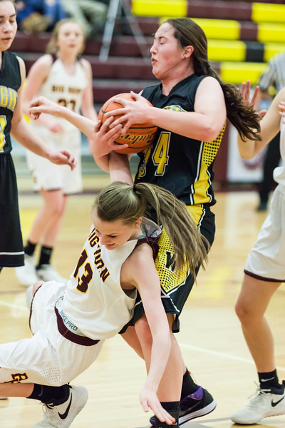 Tibby McDowell | The Sheridan Press<br /> <br /> Sydney Schmidt, left, gets entangled with a Wright defender at Big Horn High School Friday Jan. 26, 2018.