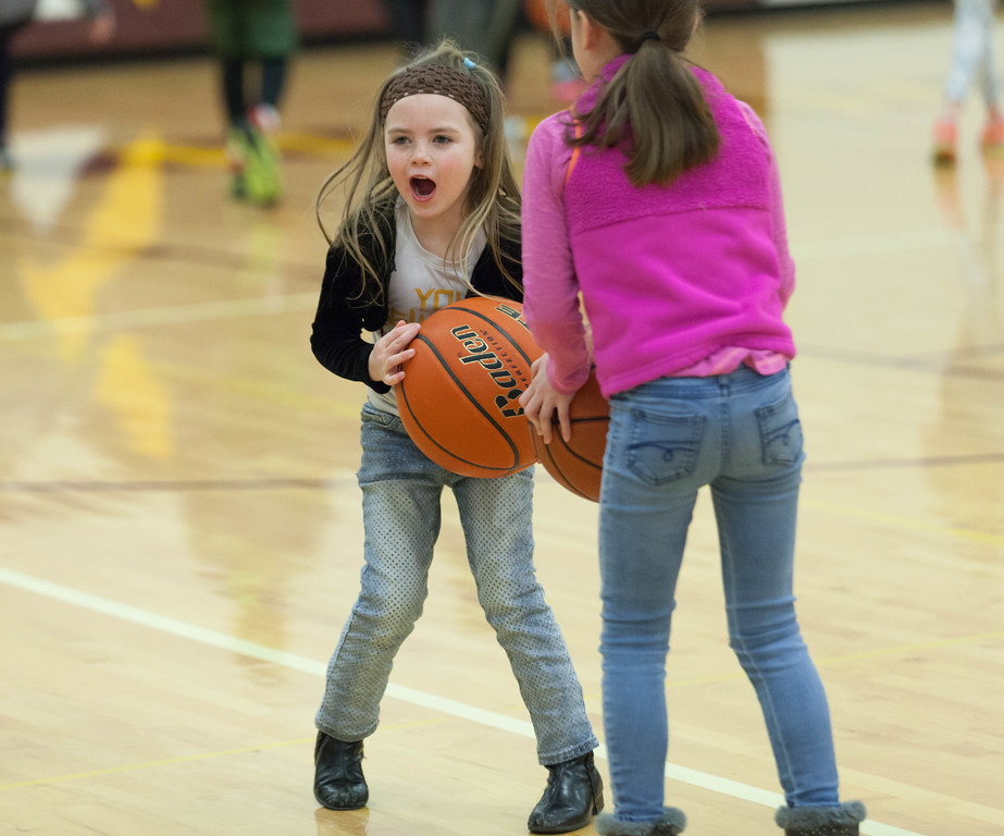 Tibby McDowell | The Sheridan Press<br /> <br /> Raegan Rosselott plays basketball on the court during half-time of the boys basketball game at Big Horn High School Friday Jan. 26, 2018.