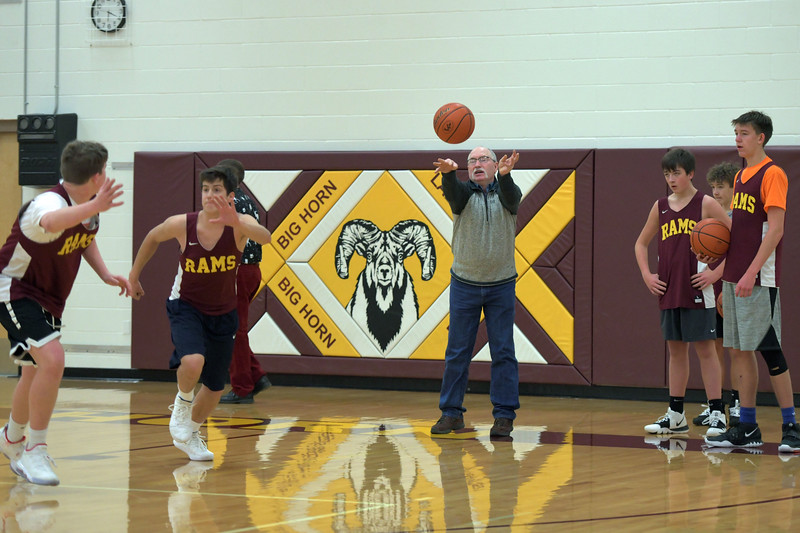 Joel Moline | The Sheridan Press<br /> Big Horn's head boys basketball coach Mike Daley passes the ball in to start a drill during practice Wednesday, Dec. 18, 2019.