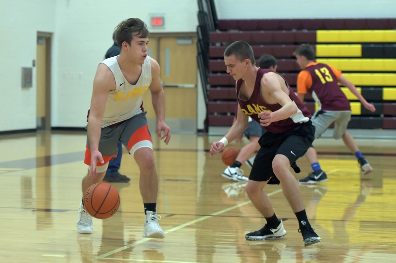 Joel Moline | The Sheridan Press<br /> Big Horn's Cutler Bradshaw, left, dribbles the ball against Eli Phillips during practice Wednesday, Dec. 18, 2019.