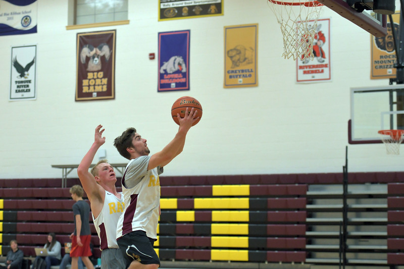 Joel Moline | The Sheridan Press<br /> Big Horn's Carson Bates attempts a layup with Quinn McCafferty trailing him during practice Wednesday, Dec. 18, 2019.