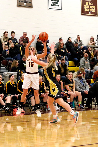 Matthew Gaston | The Sheridan Press<br>Big Horn's Jenny Trabert (15) sinks the three from way outside against Wright Friday, Feb. 15, 2019.