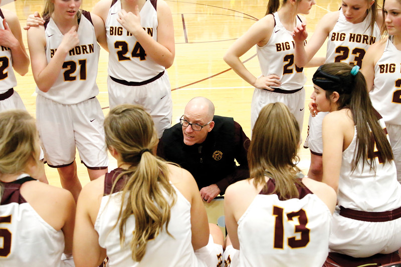 Matthew Gaston | The Sheridan Press<br>Big Horn's head coach Kip Butler lays out the game plan for the Lady Rams before their game with Wright Friday, Feb. 15, 2019. The Lady Rams won 58-47.