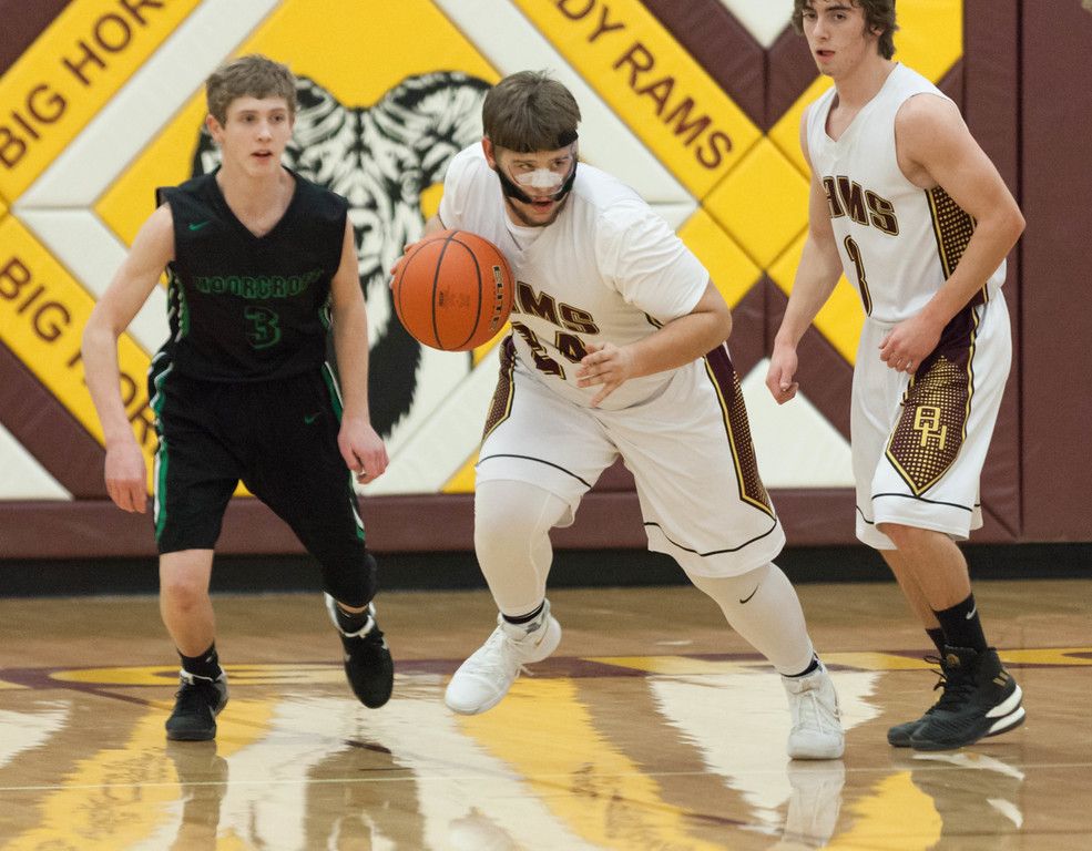 Tibby McDowell | The Sheridan Press<br /> <br /> Jaxon Parker, center, plays in a face guard due to a broken nose at Big Horn High School Friday Feb 2, 2018. The Rams beat the Moorcroft Wolves 74-34.