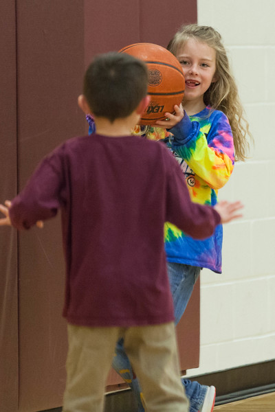 Tibby McDowell | The Sheridan Press<br /> <br /> Jesse DeHaven plays keep away from her brother James during half-time of the Lady Wolves vs Moorcroft basketball game at Big Horn High School Friday Feb 2, 2018.