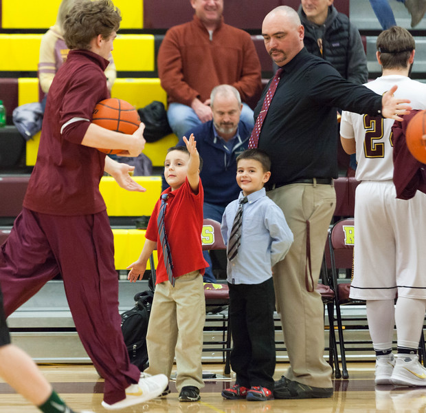 Tibby McDowell | The Sheridan Press<br /> <br /> Jacob Alley, left, and Max Alley, center, help dad and head coach Ryan Alley, right, with high fives before the game at Big Horn High School Friday Feb 2, 2018.