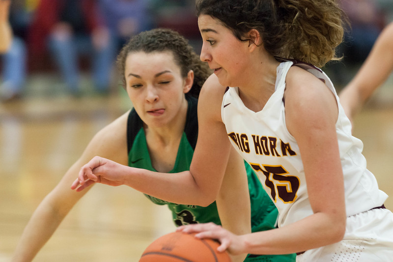 Tibby McDowell | The Sheridan Press<br /> <br /> Jenny Trabert dribbles downcourt against the Moorcroft Wolves at Big Horn High School Friday Feb 2, 2018.  The Lady Rams handily beat the Wolves 46-29.