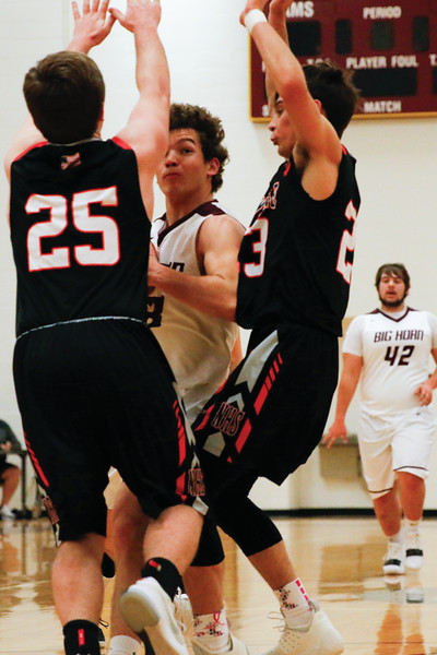 Matthew Gaston | The Sheridan Press<br>Big Horn's Kade Eisele (23) splits the defense drawing the foul Saturday, Feb. 2, 2019. Newcastle won 66-64.