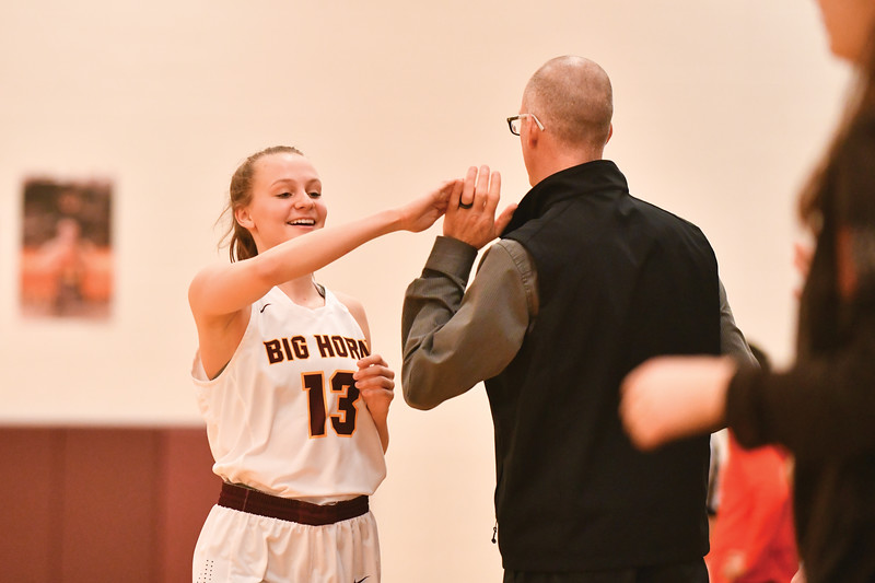 Matthew Gaston | The Sheridan Press<br>Sydney Schimdt (13) high fives head coach Kip Butler as she comes off the court Saturday, Feb. 2, 2019.