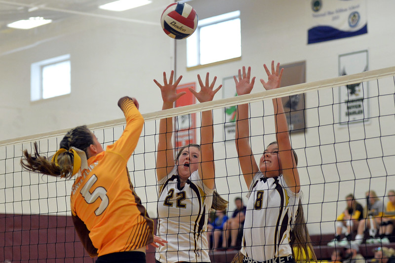 Joel Moline | The Sheridan Press<br /> Big Horn's Cheyann Price (8) and Amelia Gee (22) attempts to block a spike against Rocky Mountain Saturday, Sept. 14, 2019.