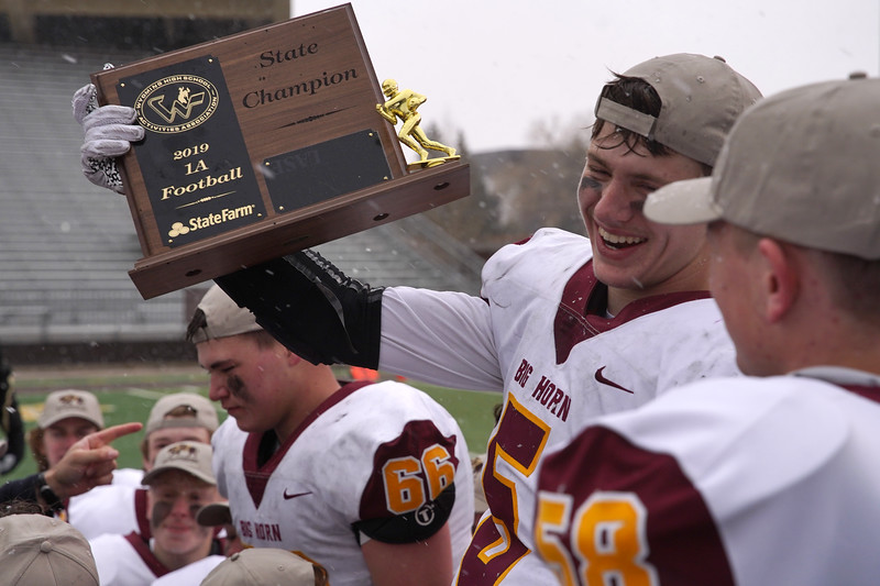 Matthew Gaston   The Sheridan Press<br>Big Horn's Will Pellissier holds up the 1A State Championship trophy at War Memorial Stadium Saturday, Nov. 16, 2019.