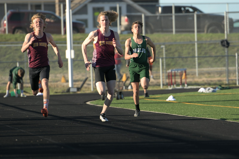 Matthew Gaston | The Sheridan Press<br>Big Horn's Blake Billings takes the lead during the 100-meter dash at the meet against Tongue River Thursday, April 18, 2019.