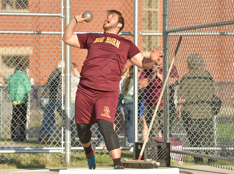 Ryan Patterson | The Sheridan Press<br /> Big Horn's Jaxon Parker competes in the shot put during a dual track meet at Big Horn High School Thursday, April 18, 2019. Parker placed third in the event with a distance of 41 feet.