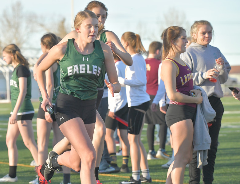 Ryan Patterson | The Sheridan Press<br /> Tongue Rivier's Kalie Bocek receives a handoff from Holly Hutchinson in the 1600-meter relay during a dual track meet at Big Horn High School Thursday, April 18, 2019. The team of Bocek, Hutchinson, Jane Pendergast and Grace Sopko won the event with a time of 4 minutes, 27.02 seconds.
