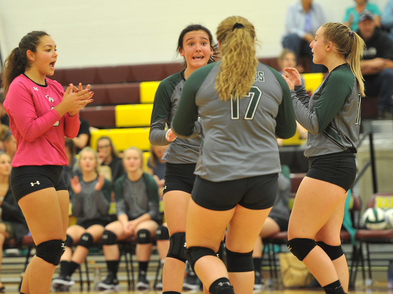 Ryan Patterson | The Sheridan Press<br /> From left: Tongue River players Raessa Williams, Izabella Carbert, Emma Scammon and Sydnee Ptiman cheer after a point at Big Horn High School Saturday, Sept. 22, 2018. Big Horn defeated Tongue River 25-18, 25-22, 25-14.