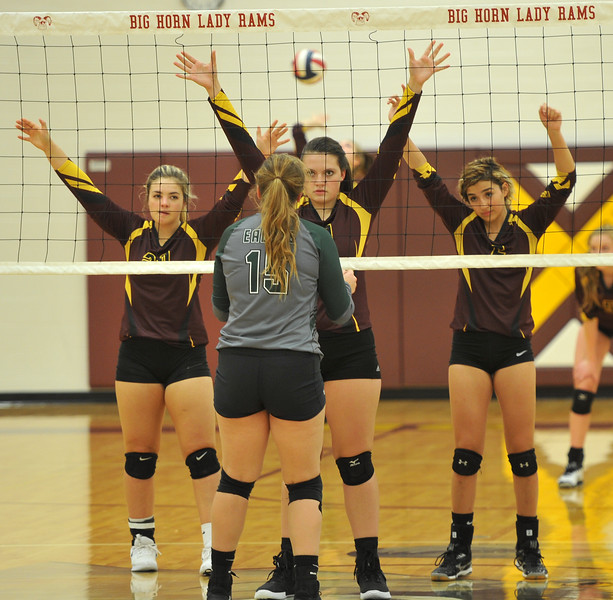 Ryan Patterson | The Sheridan Press<br /> Tongue River's Morgan Warren (15) faces, from left, Big Horn's Shyan Davidson, Taylor Meineke and Jenny Trabert before a serve at Big Horn High School Saturday, Sept. 22, 2018. Big Horn defeated Tongue River 25-18, 25-22, 25-14.