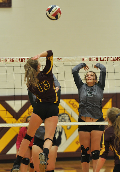 Ryan Patterson | The Sheridan Press<br /> Big Horn's Sydney Schmidt hits the ball while Tongue River's Morgan Warren goes for a block at Big Horn High School Saturday, Sept. 22, 2018. Big Horn defeated Tongue River 25-18, 25-22, 25-14.
