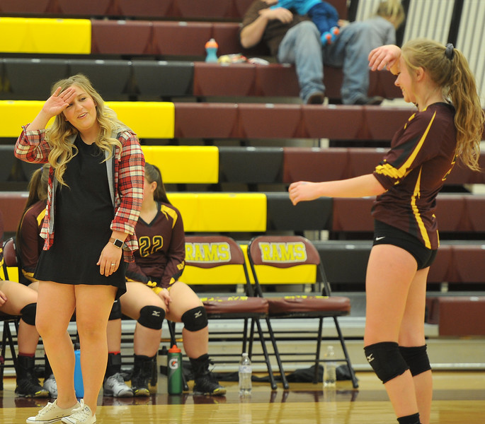 Ryan Patterson | The Sheridan Press<br /> Big Horn head coach Katie Stewart talks with Jordan Frank at Big Horn High School Saturday, Sept. 22, 2018. Big Horn defeated Tongue River 25-18, 25-22, 25-14.